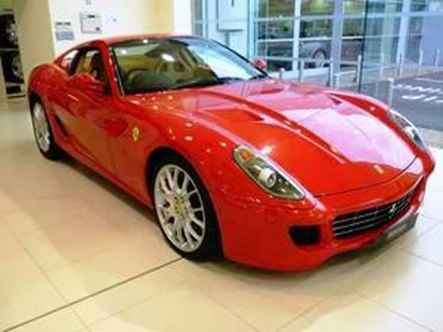 Maserati and Ferrari Showroom, Colchester, Red Ferrari on Tiled Floor